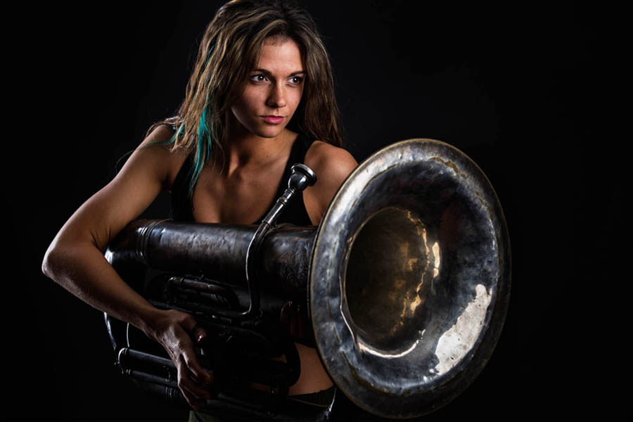 portrait medford woman holding antique tuba