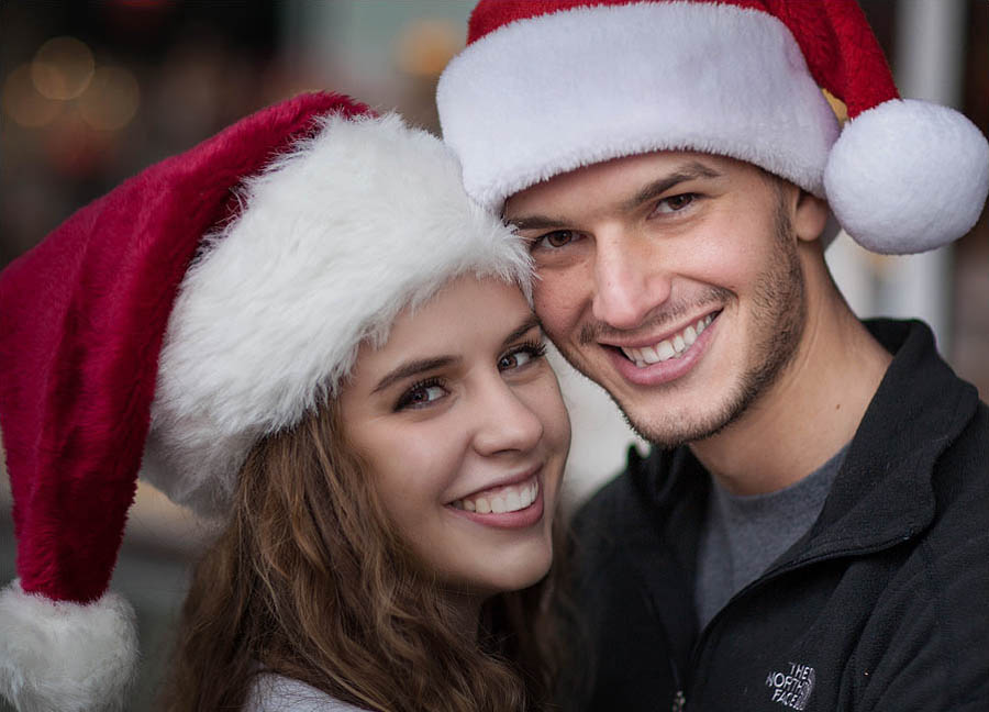 engagement photo session with Christmas Santa hats at Grants Pass