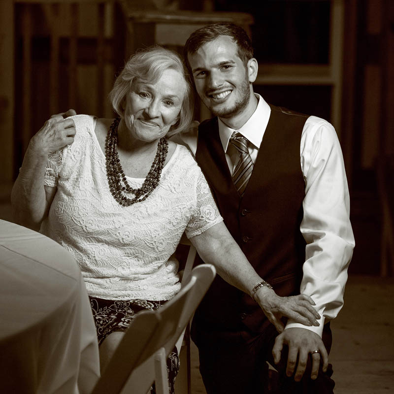 medford groom and grandmother at barn wedding reception