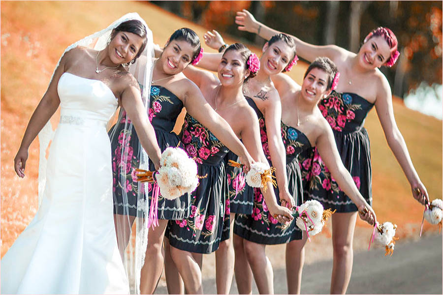 bridesmaids and bride laughing holding bouquets